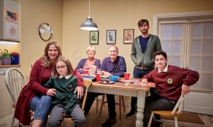 Jessica Hynes as Emily with Miley Locke as Rosie (front left) and David Tennant as Simon (standing).