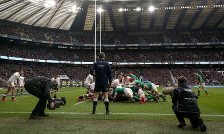 TV cameras and sound technicians swarm the touchline during a scrum as England face Ireland in the 2020 Six Nations.