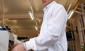 A student in a lab coats at the chemistry laboratory at Imperial College London, who get higher funding than less sucessful and prestigious universities. A university chemistry science lab, for Education front cover.