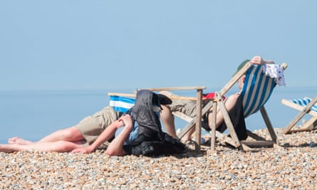 Beachgoers in Brighton enjoy the high temperatures