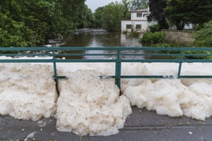 Foam washed up by the high water of the Aisch River has piled up at the bridge near the Lauf mill in Lauf, Germany
