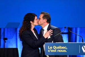 The Bloc Québécois leader, Yves-François Blanchet, kisses his wife, Nancy Déziel, in Montreal