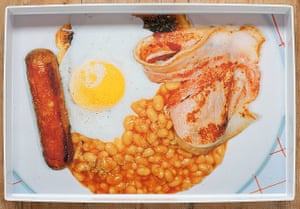 A tray with a photo of an English breakfast