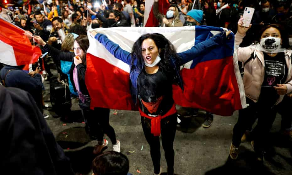 A woman holds a Chilean flag in Valparaiso last year. In a referendum in October, Chileans voted by a 79% landslide majority in favor of a popularly elected citizen assembly with gender parity.