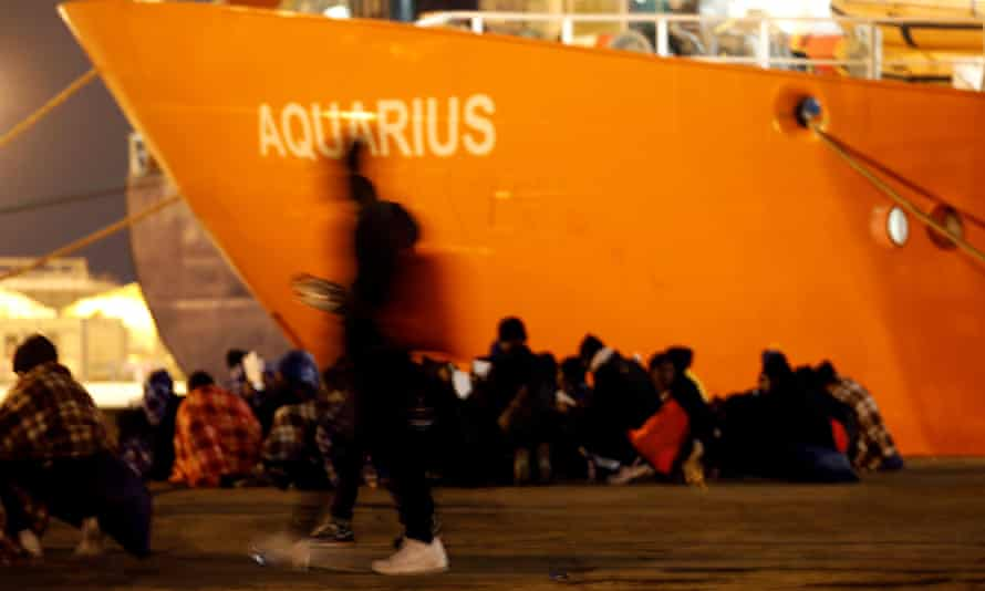 Migrants disembark from the Aquarius after its arrival in Sicily in January
