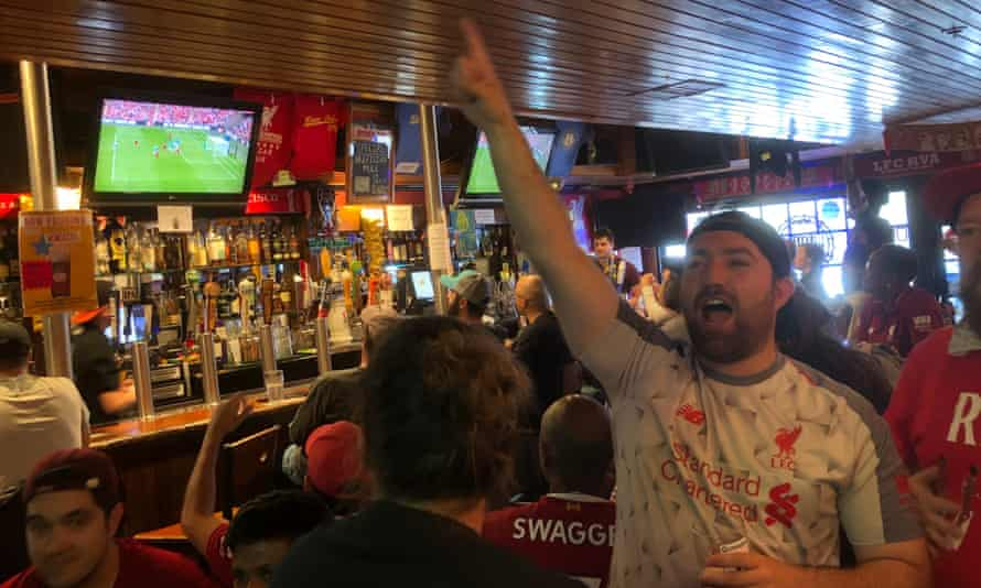 Liverpool fans down early-morning beers and watch the Community Shield in the Kezar bar in San Francisco.