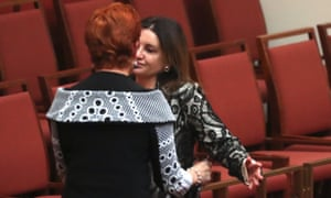 Pauline Hanson and Jacqui Lambie embrace after voting with the Greens and Labor to defeat the bill.