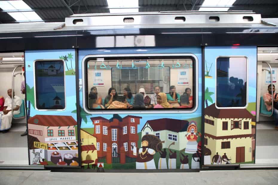 Passengers are seen inside a Kochi Metro train at Edapally metro station in Kochi