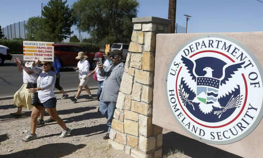 This June 2018 photo shows protesters walking along Montana Avenue outside the El Paso processing center, in El Paso, Texas, where some of the immigrants who have been on hunger strike for nearly a month are being force-fed.