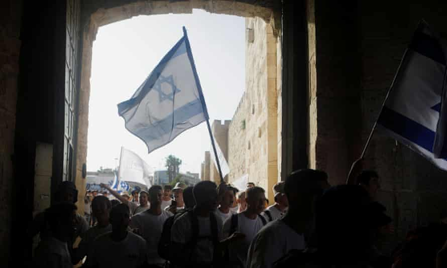 Youths wave Israeli flags during a parade marking Jerusalem Day.