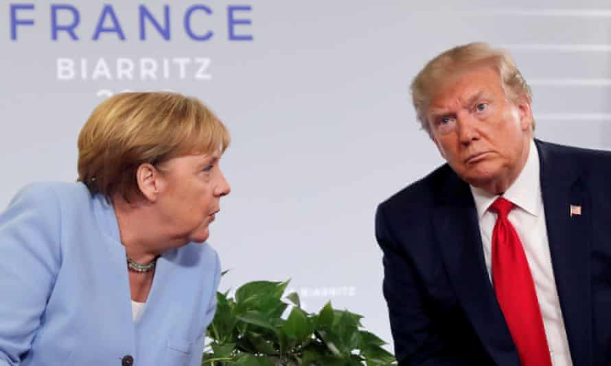 """Donald Trump meets Angela Merkel at the G7 summit in Biarritz, France, in 2019. 'He has always been particularly rude to Merkel,"""" a former White House official said."""