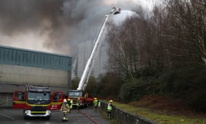 Firefighters bring the fire at the Ocado robotic warehouse in Andover under control.