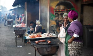 Women barbecue food in Nyanga township in Cape Town.