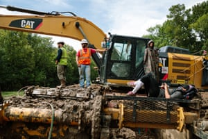 Opponents of the pipeline have locked themselves to machinery.