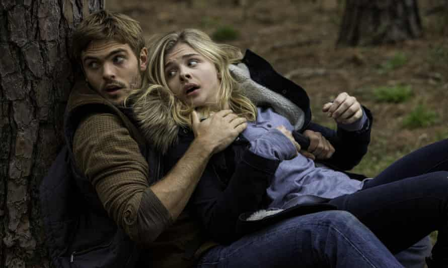Alex Roe, left, and Chloe Grace Moretz in The 5th Wave.