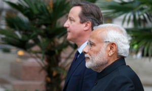 David Cameron and Narendra Modi's leave after paying homage at the statue of Mahatma Gandhi in Parliament Square