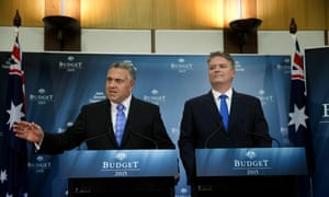 Hockey is flanked by the finance minister Mathias Cormann at the media conference.
