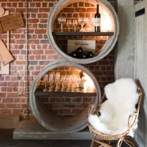 Concrete pipe sections in the bar with wine and glasses on shelves inside at the Jam Hotel, Brussesls.