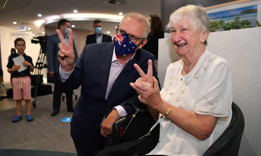Scott Morrison with aged care resident Jane Malysiak as she waits to receive her second Covid-19 vaccination in Sydney, 14 March, 2021.