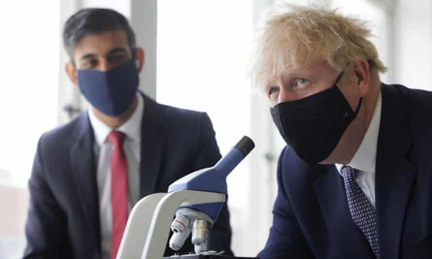 Rishi Sunak and Boris Johnson visiting a London school in April.