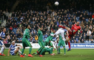 In the Friday night game, Watford goalkeeper Heurelho Gomes punches clear as Toni Leistner of QPR challenges