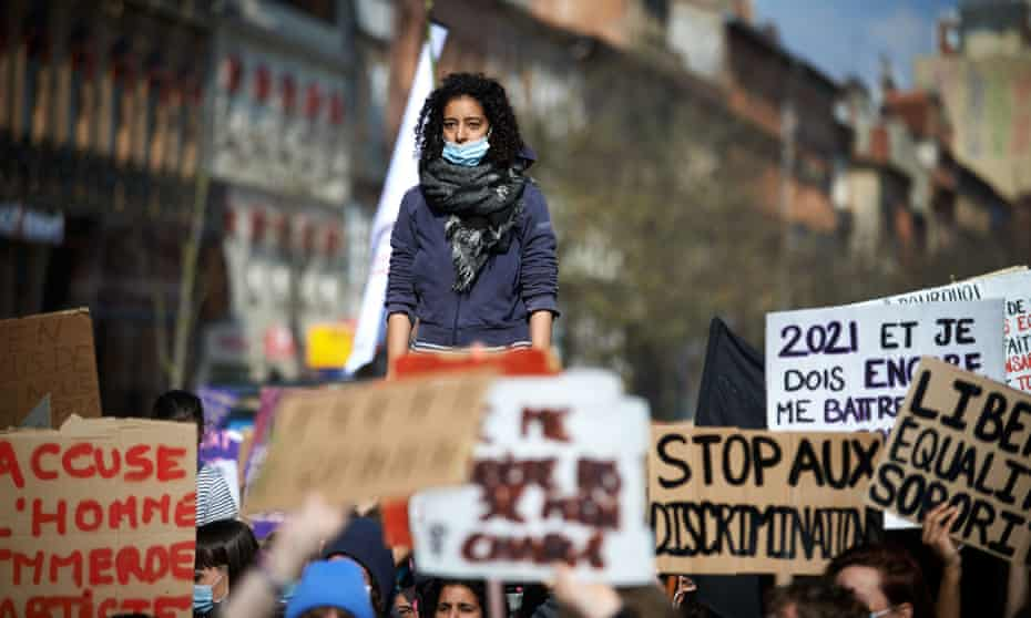 Women protest violence against women during a march in Toulouse, France.