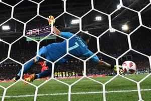 David Ospina gets a hand to Dier's penalty but fails to keep it out.