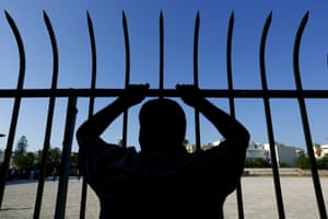 <strong>Kos, Greece</strong> A Syrian refugee stands behind a metal fence at the national stadium. Local authorities are struggling to cope with the increasing numbers of migrants and refugees arriving in dinghies from the nearby Turkish coast