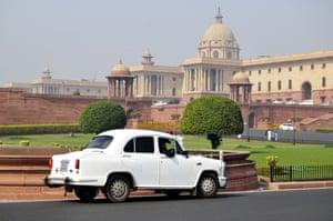 A white ambassador government car at Parliament House.