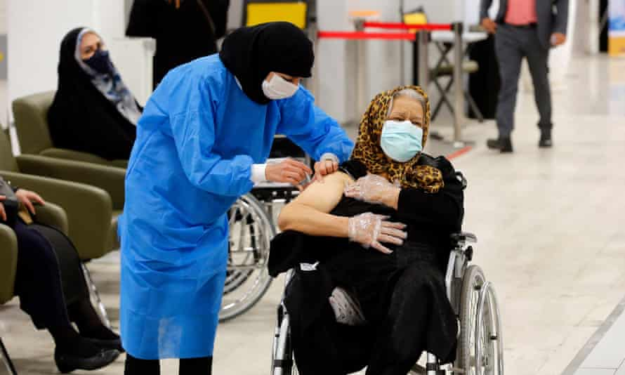 An elderly woman receives the Sinopharm COVID-19 vaccine at the Iran Mall shopping centre, in Tehran, in May 2021.