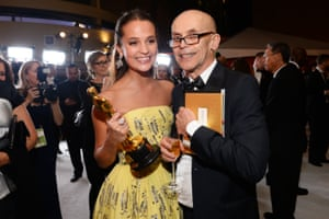 "Alicia Vikander, left, winner of the award for best actress in a supporting role for ""The Danish Girl"", and Svante Vikander at the Governors Ball"