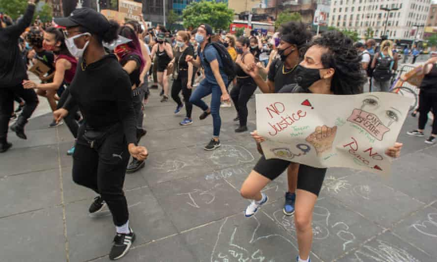 People do the Electric Slide at a Dance for George protest in New York on 7 June.