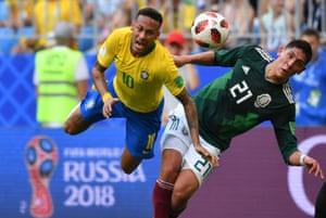Neymar flies through the air after Mexico's defender Edson Alvarez makes contact.