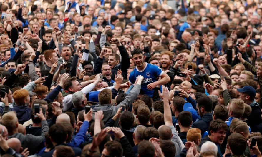 Portsmouth's Conor Chaplin celebrates with the fans after the club secured promotion to League One last month.