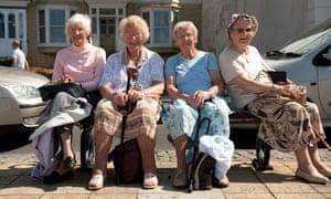 Elderly women sit on bench