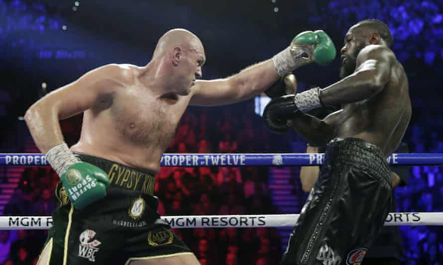 Tyson Fury throws a left at Deontay Wilder when they fought in February 2020