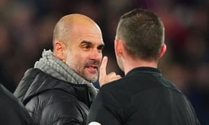 The Manchester City manager, Pep Guardiola, has words with Michael Oliver after Sunday's defeat to Liverpool at Anfield.