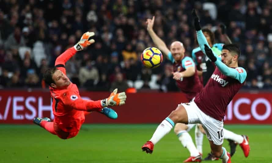 Asmir Begovic of Bournemouth (left) pulls off a save against West Ham's Manuel Lanzini at the London Stadium in January 2018.