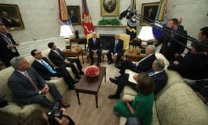 Donald Trump in the Oval Office with Mike Pence, Steven Mnuchin, Paul Ryan, Mitch McConnell, and Democrats Chuck Schumer and Nancy Pelosi.