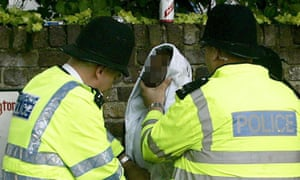 Police stop and search of a young man.