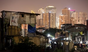 Manila's financial district, seen from a slum area.