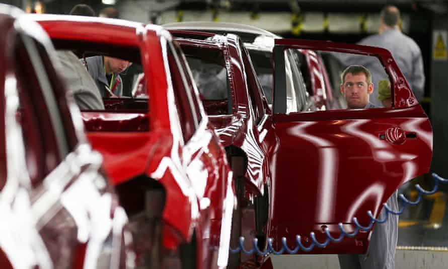 A technician assembles a car on the production line at Nissan's Sunderland plant.