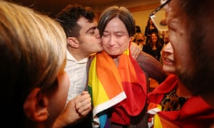 Sam Dastyari embraces an emotional Penny Wong.