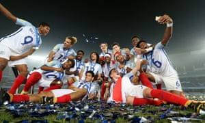 The England players pose with the trophy, and take a few selfies after winning the FIFA U-17 World Cup.