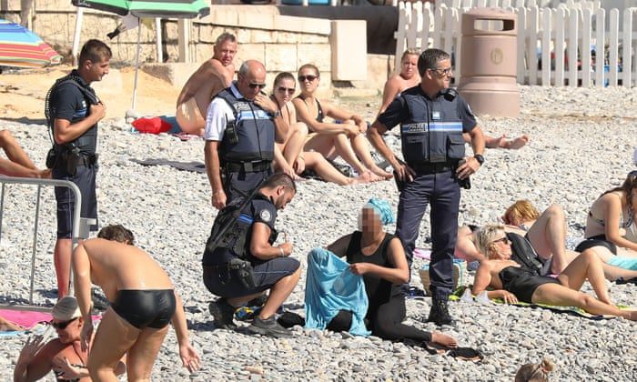 french police make woman remove clothing on nice beach following