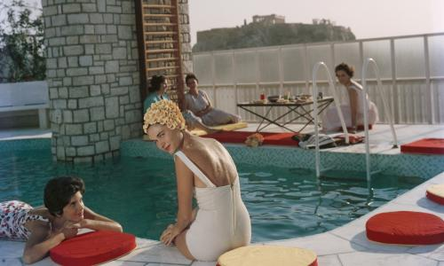 Guests relax around the Canellopoulos penthouse pool, Athens, 1961.