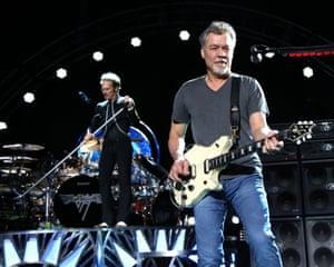 David Lee Roth, left, and Eddie Van Halen of Van Halen perform on Aug. 13, 2015, in Wantagh, N.Y. Van Halen, who had battled cancer, died Tuesday, Oct. 6, 2020. He was 65.