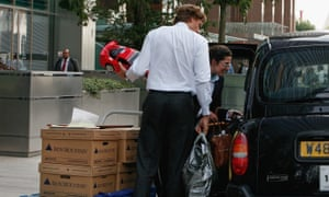 Employees leave Lehman Brothers' Canary Wharf office carrying belongings in September 2008.