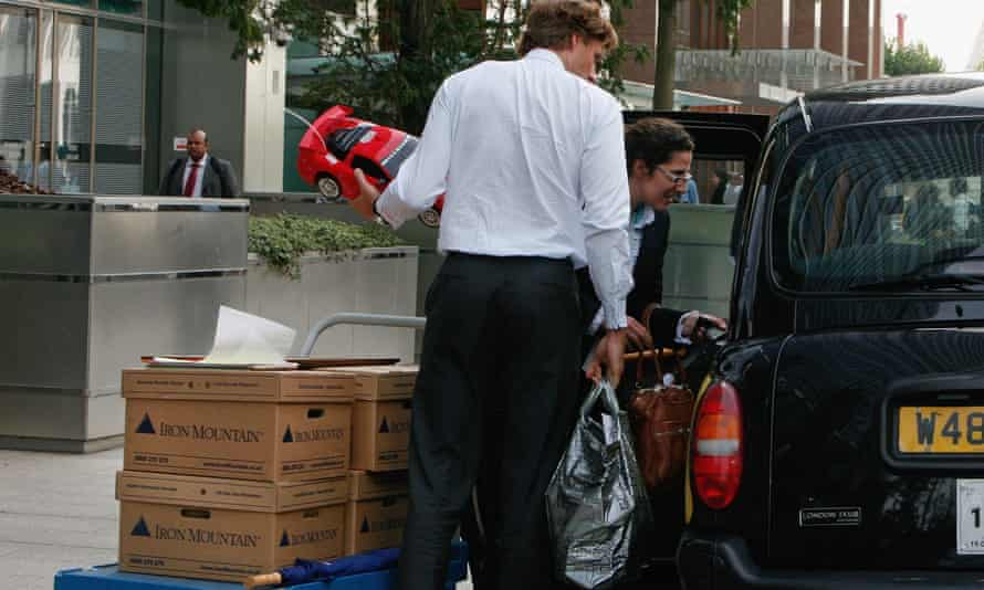 Employees of Lehman Brothers in Canary Wharf, London, after its collapse in 2008.