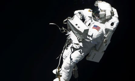 An astronaut works outside the International Space Station, 2009